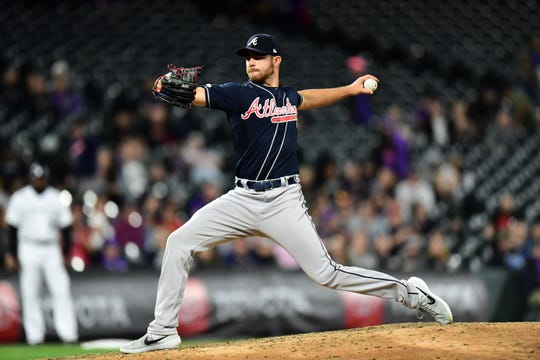 Apr 9, 2019; Denver, CO, USA; Atlanta Braves relief pitcher Jesse Biddle (19) delivers a pitch in the inning against the Colorado Rockies  at Coors Field. Mandatory Credit: Ron Chenoy-USA TODAY Sports