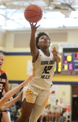 Walnut Hills guard Darian Burgin drives to the basket during the basketball game against Loveland, Saturday, Jan.18, 2020.