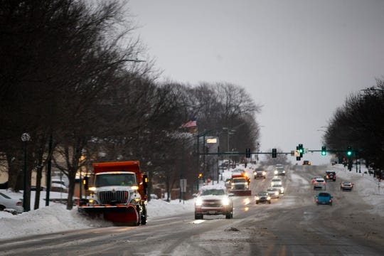 Plows clear snow from University Ave. on Friday, Jan. 17, 2020, in Windsor Heights.