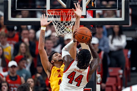 Texas Tech's Chris Clarke (44) shoots over Iowa State's George Conditt IV (4) during the first half of an NCAA college basketball game Saturday, Jan. 18, 2020, in Lubbock, Texas. (AP Photo/Brad Tollefson)