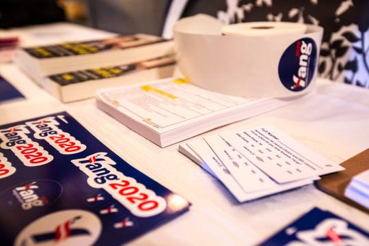 Preference cards for Democratic presidential candidate Andrew Yang are displayed on a table with stickers and information about the candidate during a town hall campaign event, Saturday, Jan. 18, 2020, at the Giving Tree Theater in Marion, Iowa.