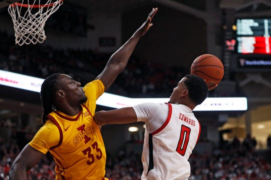 Texas Tech's Kyler Edwards (0) shoots around Iowa State's Solomon Young (33) during the first half of an NCAA college basketball game Saturday, Jan. 18, 2020, in Lubbock, Texas. (AP Photo/Brad Tollefson)