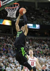Michigan State's Xavier Tillman dunks against Wisconsin during the second half at the Breslin Center in East Lansing, Friday, Jan. 17, 2020. The assist from Cassius Winston set the new record formerly held by Mateen Cleaves.