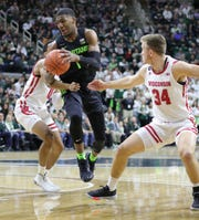 Aaron Henry drives during the first half at the Breslin Center on Friday.