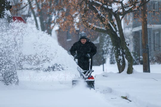 John Weted of Detroit uses a snow blower to clear the sidewalks in front of his house on Jan. 18, 2020. Snow is predicted to fall Sunday.