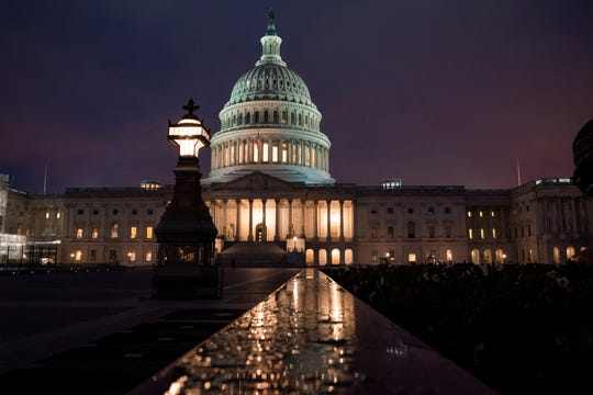 The Capitol is seen in Washington, early Wednesday, Jan. 15, 2020, as the House is set to vote to send the articles of impeachment against President Donald Trump to the Senate for a landmark trial on whether the charges of abuse of power and obstruction of Congress are grounds for his removal.