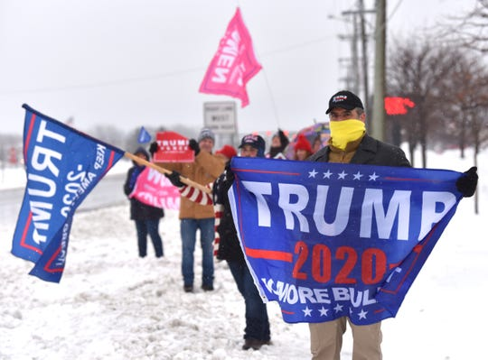 Eric (no last name given), of Sterling Heights, shows support for President Trump on Saturday.