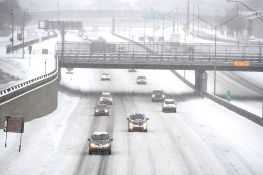 Motorists traveling along Interstate 75 near Woodward Heights Avenue in Ferndale encounter snow and ice conditions on Saturday, January 18, 2020.