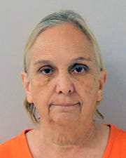 This undated booking photo provided by The Walker County Sheriff's Office shows Debra Van Horn.