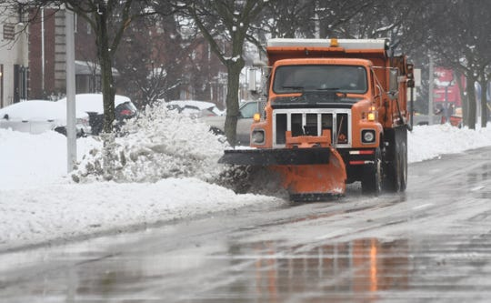 A snow plow clears snow and ice along Coolidge Highway in Oak Park after a massive snow storm hit the metro Detroit area in Saturday, January 18, 2020. Max Ortiz, The Detroit News