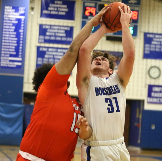 Henry Juan of Horseheads goes up for a shot as Union-Endicott's Clayton Hughes defends during the Blue Raiders' 69-65 win in boys basketball Jan. 17, 2020 at Horseheads Middle School.