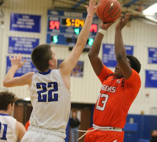Adrese Bradford of Union-Endicott takes a shot as Horseheads' Andrew McLaughlin defends during the Blue Raiders' 69-65 win in boys basketball Jan. 17, 2020 at Horseheads Middle School.