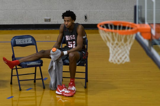 Bosse's Kiyron Powell (52) sits on the sideline after injuring his knee in the third quarter of the Banterra Bank SIAC Tournament semifinal against the Reitz Panthers at Reitz High School in Evansville, Ind., Friday, Jan. 17, 2020. The Bosse Bulldogs defeated the Reitz Panthers, 93-73.