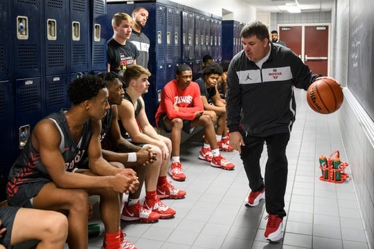 Bosse Coach Shane Burkhart, right, talks to his team during halftime of the Banterra Bank SIAC Tournament semifinal against the Reitz Panthers at Reitz High School in Evansville, Ind., Friday, Jan. 17, 2020. The Bosse Bulldogs defeated the Reitz Panthers, 93-73.