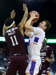 Evansville's Noah Frederking (30) shoots over Missouri State's Isiaih Mosley (11) during the first half at Ford Center in Evansville, Ind., Saturday, Jan. 18, 2020. The Purple Aces fell 68-58 to the Bears.