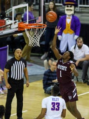 Missouri State's Keandre Cook (1) shoots the ball during the first half against the University of Evansville Purple Aces at Ford Center in Evansville, Ind., on Saturday.