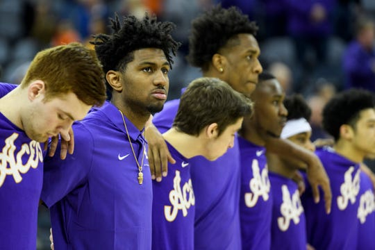 Samari Curtis, second from left, stands with his new team as the National Anthem plays before the Missouri State Bears versus University of Evansville Purple Aces game at the Ford Center in Evansville, Ind., Saturday, Jan. 18, 2020. The freshman transferred from Nebraska.