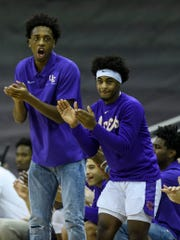 Evansville's DeAndre Williams (13) and Evansville's Shamar Givance (5) cheer on their team during the first half against the Missouri State Bears at Ford Center in Evansville, Ind., Saturday, Jan. 18, 2020. The Purple Aces fell 68-58 to the Bears.