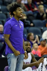 Samari Curtis, a new transfer to the University of Evansville Purple Aces, cheers on his team as they take on the  Missouri State Bears at Ford Center in Evansville, Ind., Saturday, Jan. 18, 2020. The Purple Aces fell 68-58 to the Bears.