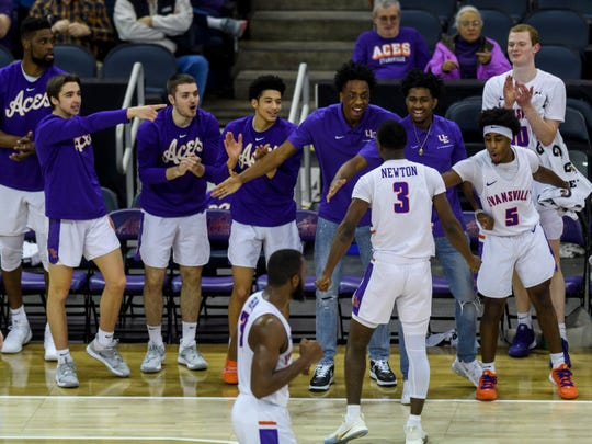 The University of Evansville Purple Aces bench cheers for Evansville's Jawaun Newton (3) after he forced Missouri State's Ja'Monta Black (4) to turn over the ball during the first half at Ford Center in Evansville, Ind., Saturday, Jan. 18, 2020.