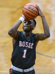 Bosse's Ty'Ran Funches (1) shoots a free-throw during the third quarter of the Banterra Bank SIAC Tournament semifinal against the Reitz Panthers at Reitz High School in Evansville, Ind., Friday, Jan. 17, 2020. The Bulldogs defeated the Panthers, 93-73.