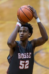 Bosse's Kiyron Powell (52) makes a free-throw during the third quarter of the Banterra Bank SIAC Tournament semifinal against the Reitz Panthers at Reitz High School in Evansville, Ind., Friday, Jan. 17, 2020. The Bulldogs defeated the Panthers, 93-73.