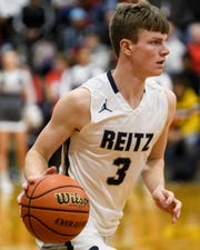 Reitz's Logan Martin (3) dribbles during the Banterra Bank SIAC Tournament semifinal against the Bosse Bulldogs at Reitz High School in Evansville, Ind., Friday, Jan. 17, 2020. The Bosse Bulldogs defeated the Reitz Panthers, 93-73.