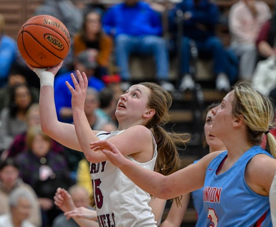 Henderson County's Sadie Wurth (15) drives to the basket at the Henderson County Lady Colonels play district rival the Union County Bravettes at Henderson's Colonel Gym Friday evening, January 17, 2020.