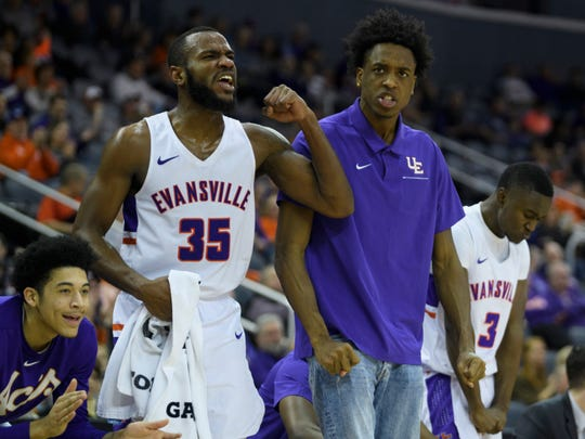 Evansville's John Hall (35), DeAndre Williams (13) and others on the bench cheer for their teammates during the second half against the Missouri State Bears at Ford Center in Evansville, Ind., Saturday, Jan. 18, 2020. The Purple Aces fell 68-58 to the Bears.