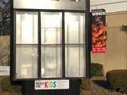 The drive-thru menu board at the former KFC at U.S. 41 and Covert Ave. in Evansville.