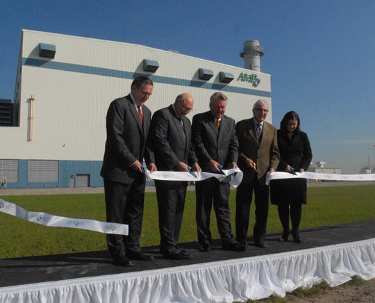 A ribbon-cutting ceremony was held in front of the American Municipal Power building in Sandusky Township on Sept 27, 2011. AMP won an appeal of its public utility personal property tax and is awaiting more than $6 million in tax reimbursements.