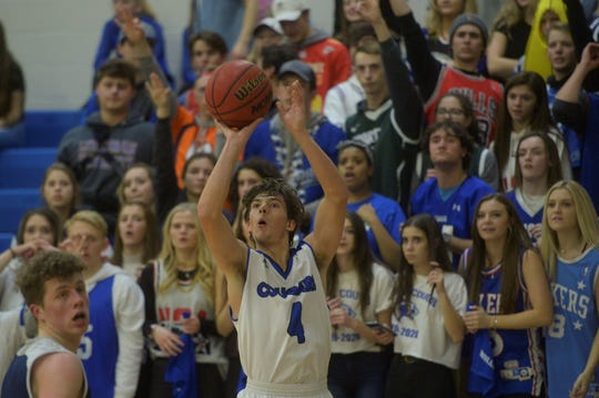 Resurrection Christian boys basketball player Zach Cook shoots during a game against University on Friday, Jan. 17, 2020. The Cougars are the unbeaten No. 1 seed in 3A and advanced to the Great 8 with a 59-40 win on Saturday