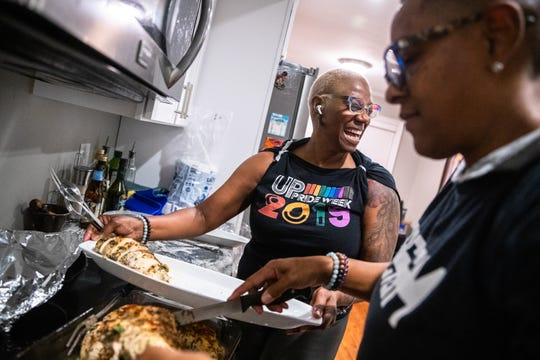Upstate Pride Vice President Caroline Caldwell, left, prepares food with fellow board member Terena Starks at a dinner party they hosted at Caldwell's home in Greenville on Friday, Jan. 17, 2020.