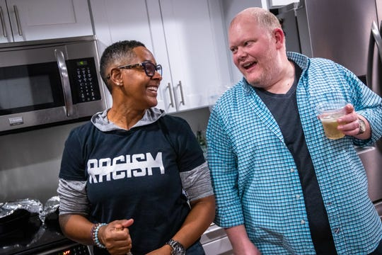 Upstate Pride diversity officer Terena Starks, left, jokes with the group's treasurer, Gary Leatherwood, at a dinner party she hosted with fellow board member Caroline Caldwell at Caldwell's home in Greenville on Friday, Jan. 17, 2020.