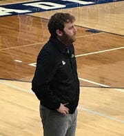 Choteau head coach Austin Schilling surveys his team from the bench during the Bulldogs' game at Fairfield Friday night.