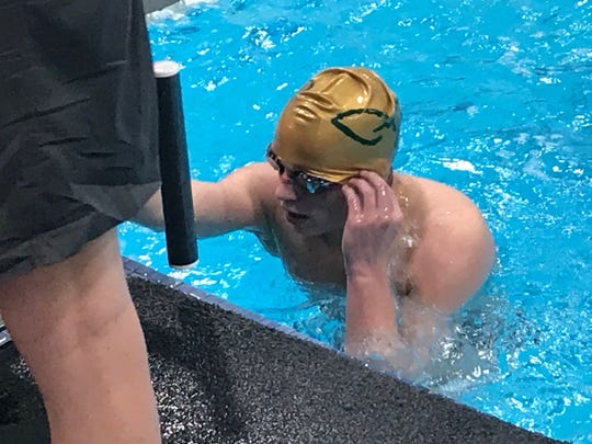 CMR swimmer Jaxon Gronning catches his breath following a dominant performance in the boys' 500-yard race at the Stacy Frey Memorial I-15 Invitational at the Bison Pool Saturday.