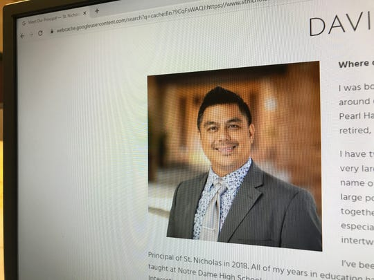 Photo of Davin Reyes from a cached version of the St. Nicolas Catholic School website. The Washington-based school hired Reyes as the principal but he was recently fired from St. Nicholas Catholic school following allegations that he gave money, drugs and alcohol to students at his former school.