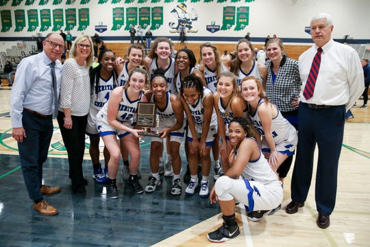 Heritage Christian players and coaches pose for a shot with their trophy following their victory during the Cathedral vs Heritage Christian Girls High School City Varsity Basketball Tourney held at Cathedral High School, January 18, 2020.