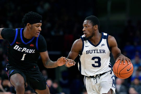 Jan 18, 2020; Chicago, Illinois, USA; Butler Bulldogs guard Kamar Baldwin (3) drives with the basketball against DePaul Blue Demons forward Romeo Weems (1) at Wintrust Arena. Mandatory Credit: Quinn Harris-USA TODAY Sports