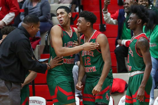 Players on the Lawrence North Wildcats bench react to a dunk during the second half of Marion County semifinals at Southport High School in Indianapolis on Friday, Jan. 17, 2020. Lawrence North won, 73-60.