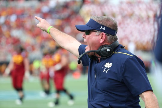 Fighting Irish head coach Brian Kelly reacts against the Iowa State Cyclones during the second half at Camping World Stadium.