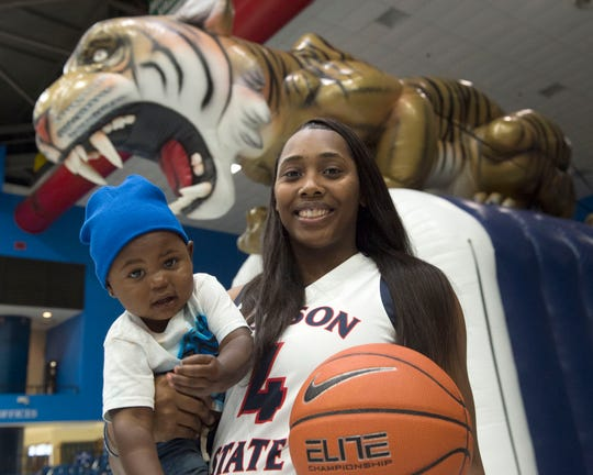 Ameshya Williams, pictured with son Jace, is a standout basketball player at Jackson State University.
