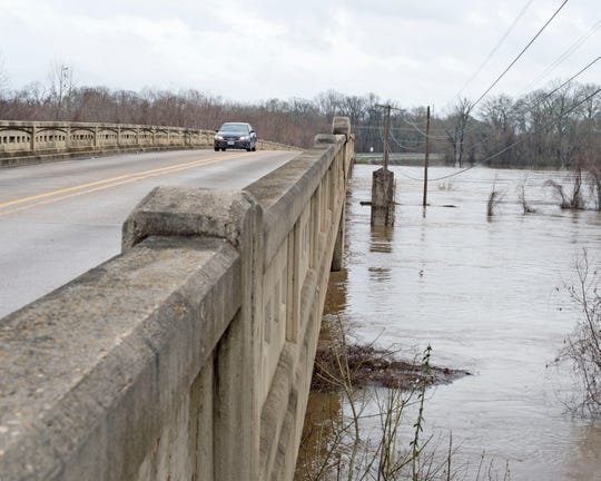 The Pearl River remains high in Jackson on Saturday as it crosses beneath the Silas Brown Bridge in downtown Jackson, Miss. Saturday, Jan. 18, 2020.