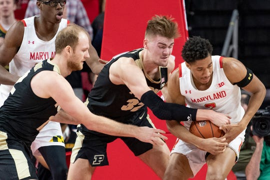 Jan 18, 2020; College Park, Maryland, USA;  Purdue Boilermakers center Matt Haarms (32) and Maryland Terrapins guard Aaron Wiggins (2) fight for a loose ball during the first half at XFINITY Center. Mandatory Credit: Tommy Gilligan-USA TODAY Sports