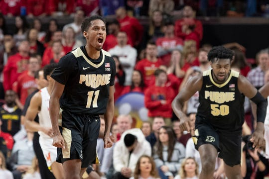 Jan 18, 2020; College Park, Maryland, USA;  Purdue Boilermakers guard Isaiah Thompson (11) reacts after making a three point shot during the second half against the Maryland Terrapins at XFINITY Center. Mandatory Credit: Tommy Gilligan-USA TODAY Sports