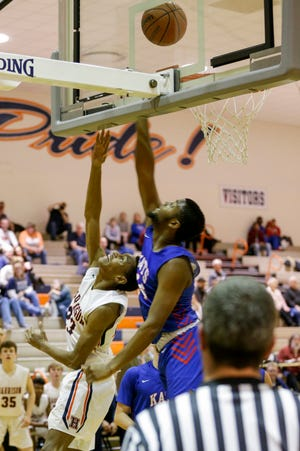 Harrison's DeAndre Alsup (23) hooks a layup into the basket against Kokomo's R.J. Oglesby (24) during the fourth quarter of an IHSAA boy's basketball game, Friday, Jan. 17, 2020 in West Lafayette.