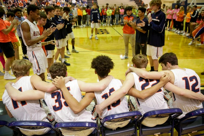 Harrison's Camden Smith (11), Bryant Smith (35), Jonah Lucas (15), Nick Matson (22) and Jordan Walters (12) wait to be announced before the first quarter of an IHSAA boy's basketball game, Friday, Jan. 17, 2020 in West Lafayette.