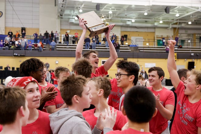 The West Lafayette boys team celebrates after placing first in the Hoosier Conference Championships, Saturday, Jan. 18, 2020 in West Lafayette.