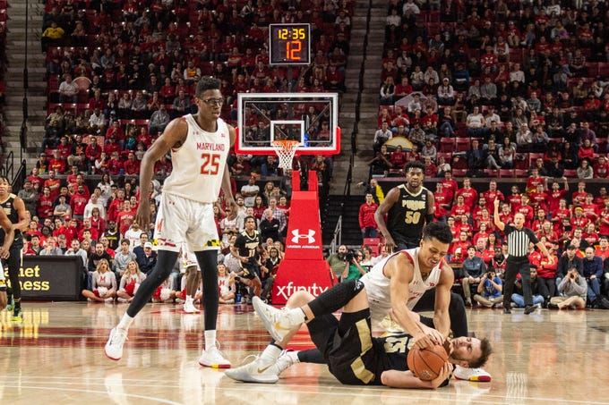 Jan 18, 2020; College Park, Maryland, USA;  Maryland Terrapins guard Anthony Cowan Jr. (1) and Purdue Boilermakers guard Sasha Stefanovic (55) dive for a loose ball during the second half at XFINITY Center. Mandatory Credit: Tommy Gilligan-USA TODAY Sports