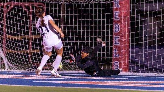 Mary-Ainsleyt Alack scores a goal as Teurlings Catholic takes on STM girls soccer.  Friday, Jan. 17, 2020.